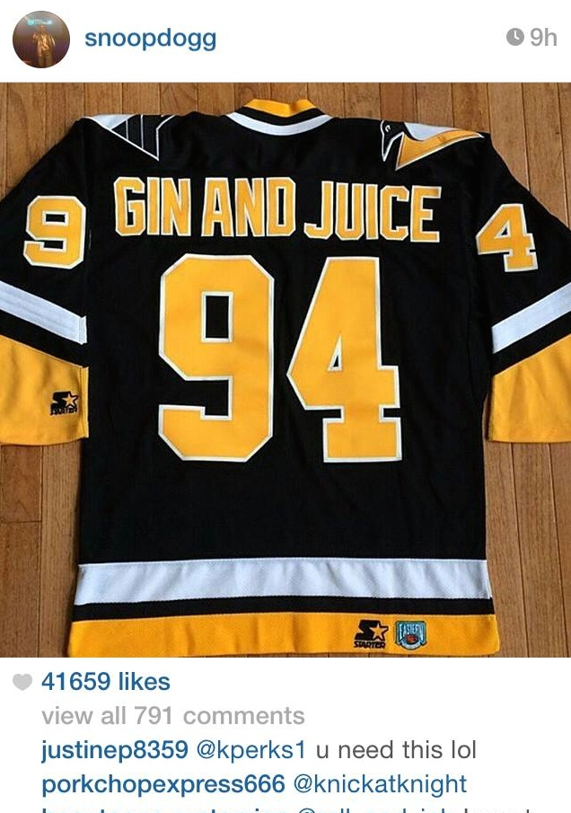 Snoop showing everyone where he got his Gin And Juice jersey from