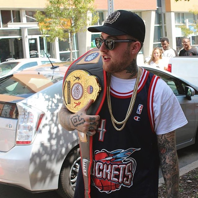 Mac Miller in his vintage Rockets jersey from Rare Vntg