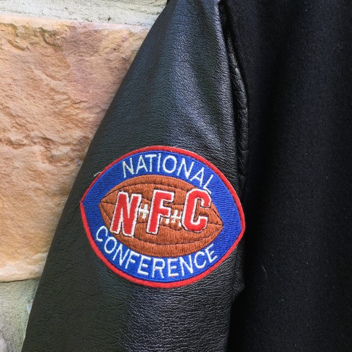vintage NFC patch on Eagles chalkline jacket